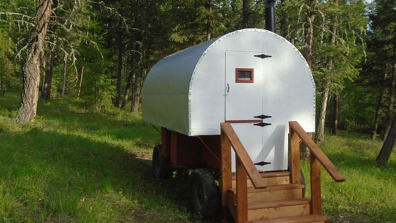 authentic sheepherder wagon camping near wilderness areas in Kootenai NFS, holiday rental in Trego