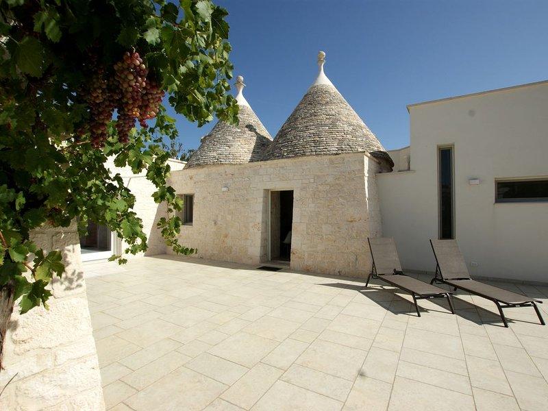 Zauberhaftes Trullo in Cisternino mit allem Komfort, kostenloses WLAN & Parken, location de vacances à Marinelli