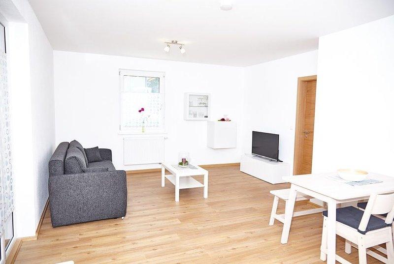 Modernes 50qm Ferienapartment mit Terrasse, kostenfreies WLAN, vacation rental in Burgpreppach