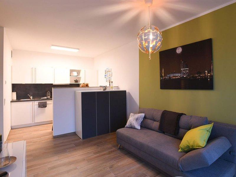 Modernes Apartment in perfekter Hafen Lage, location de vacances à Stadland