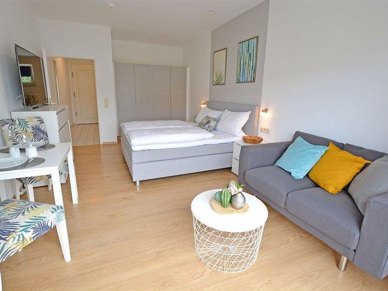 Modernes 1-Zimmer-Appartement im Kurgebiet - Balkon, WLAN, TV, innenstadtnah, Ferienwohnung in Grolsheim