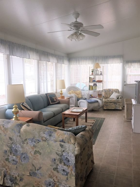 living room with two sleep sofas, two rocking chairs and a lounger