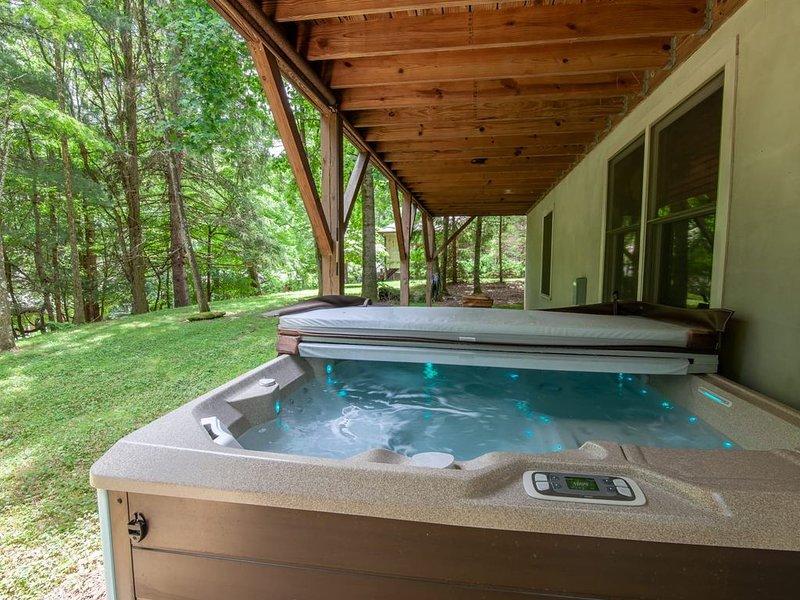 Hot Tub Sits Just Above Back Yard
