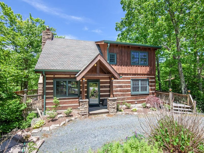 Log Exterior with Stone Columns at Front Stoop Porch makes for Great Curb Appeal!