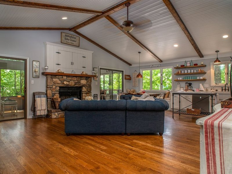 open living room with cathedral ceiling, TV, fireplace