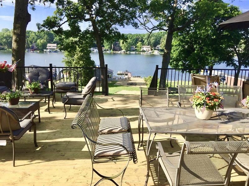 large deck with sitting, dining,  grilling, with beautiful views