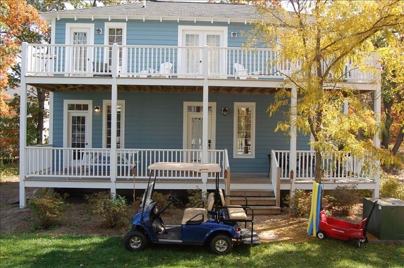 Large family home, two decks, tables/chairs, golf cart, wagon