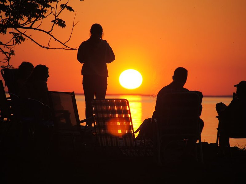 Enjoy stunning sunsets from the screen porch or new permanent fire pits.
