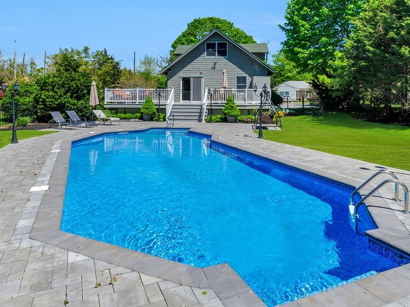 Greenport Village home w/ POOL! Steps to Town Center & Bay Beach!, casa vacanza a Greenport