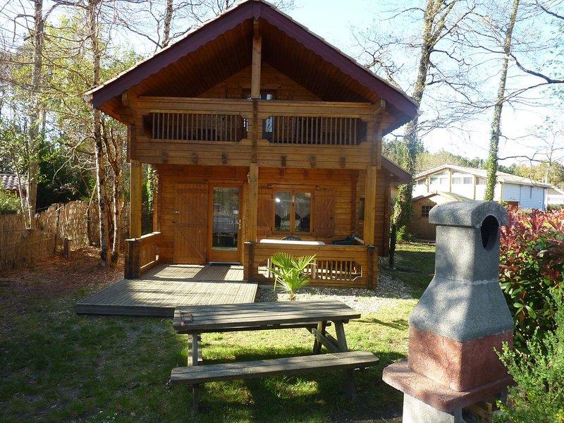 Chalet Bois dans domaine de loisirs 4*, location de vacances à Cazaux