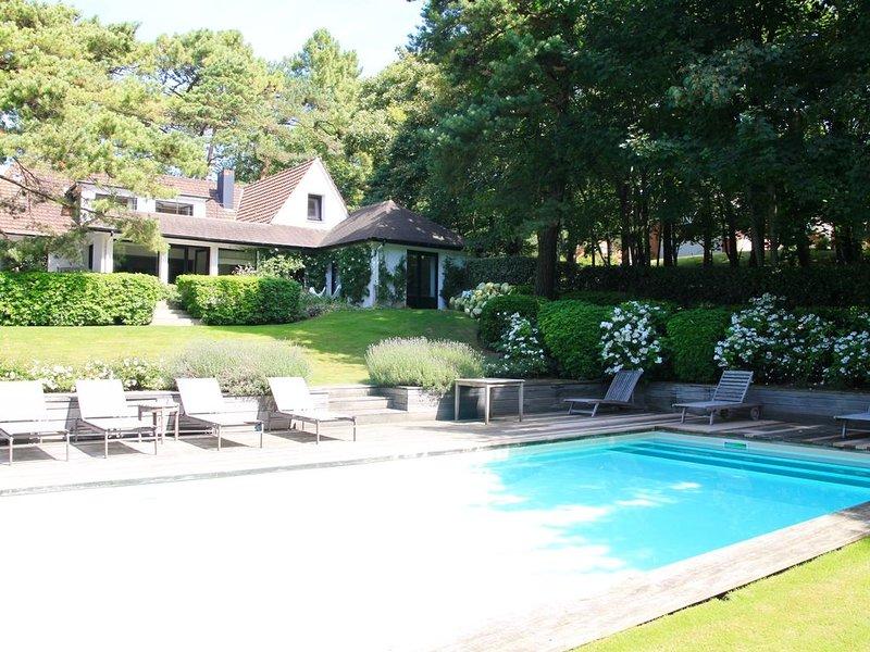 Villa avec piscine et parc paysager prés du golf, vacation rental in Stella-Plage