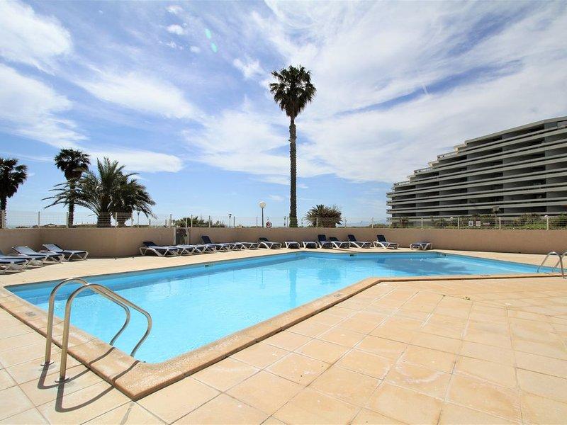 3 pièces en front de mer avec piscine et parking, holiday rental in Canet-en-Roussillon