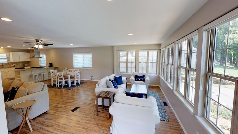Enjoy a view of the lake from the sitting area, living room, kitchen, & dining.