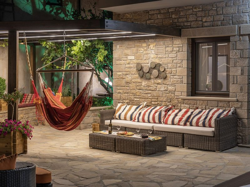 Elegant stone house with spa & beach, summer & winter, wheelchair-accessible, vacation rental in Koutsouras