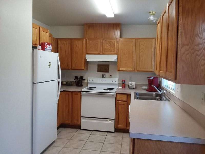 Kitchen with dinnerware/cookware/spices