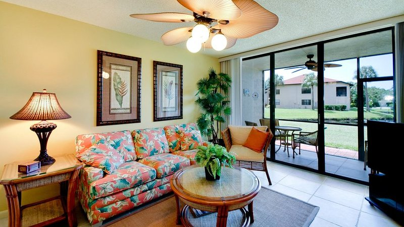 Lakefront Lliving room and screened lanai