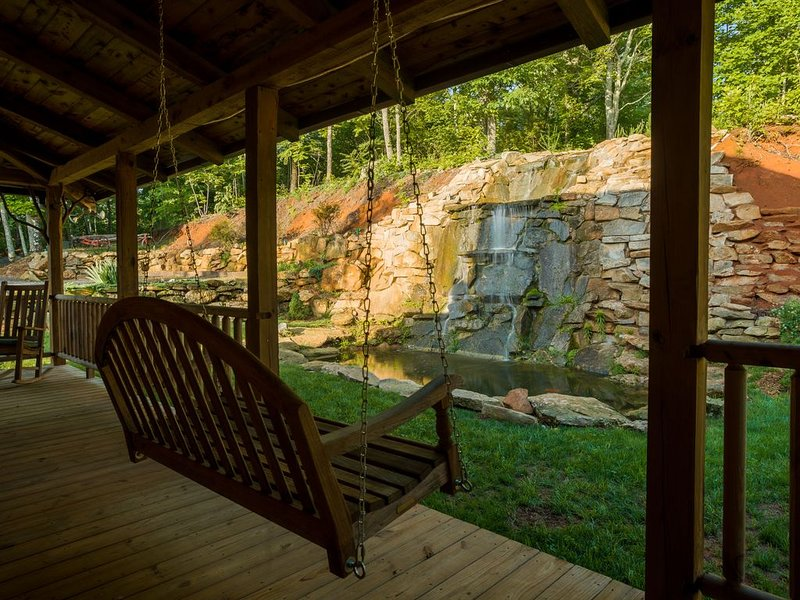 Relax on the swinging bench in front of your private 28 foot waterfall