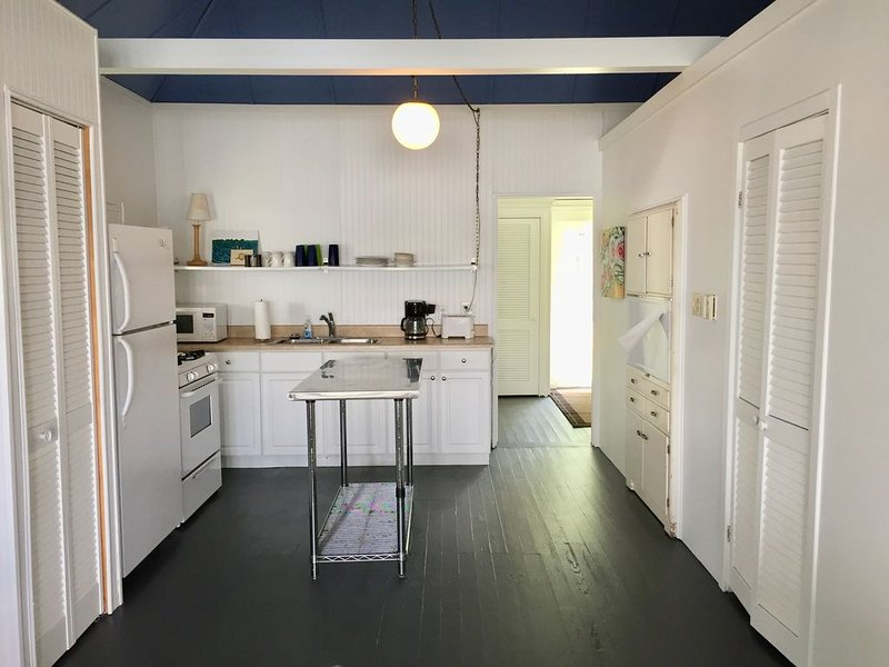 full kitchen with stove/oven, refrigerator, toaster, microwave and coffee maker