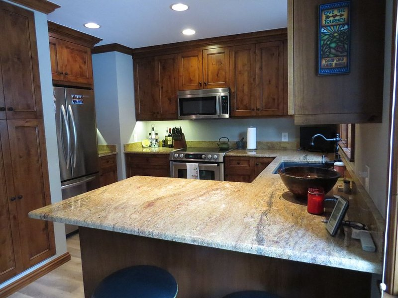 Custom alder wood cabinetry and granite counter tops.  Water purifier system.