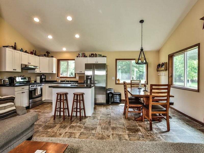 Kitchen with breakfast bar and dining space