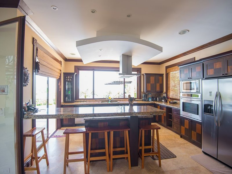 The kitchen is fully equipped, very functional, spacious & bright.