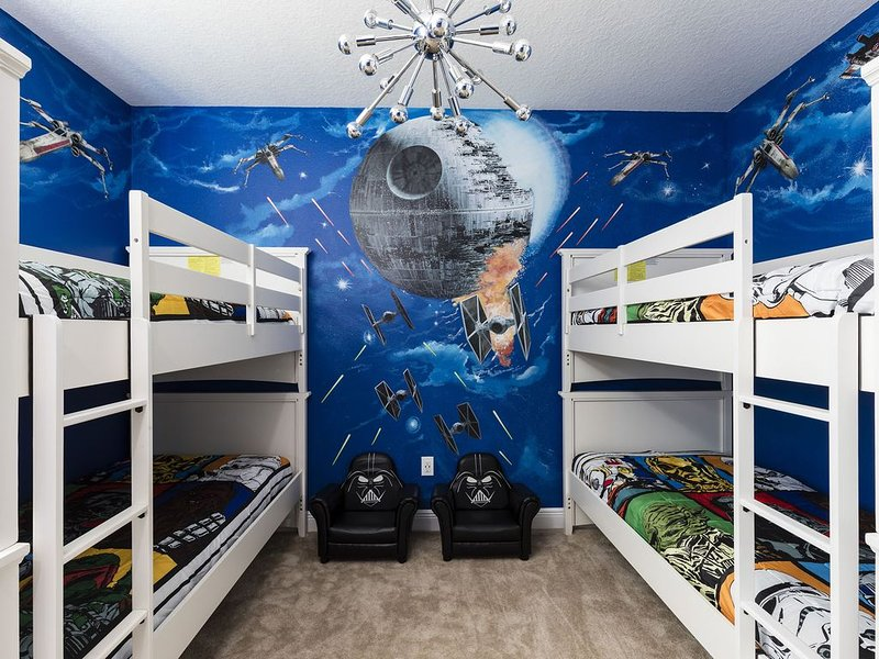 2 bunk beds (4 twin size beds) in our Star Wars room with a bathroom