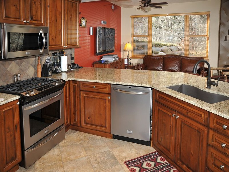 Roomy Avon Condo w/ River and Mountain Views, Free Town Shuttle Access to Slopes, vacation rental in Avon