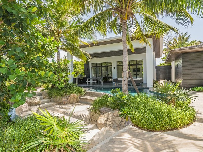 An inviting courtyard, heightened by lush private gardens., vacation rental in Turtle Beach