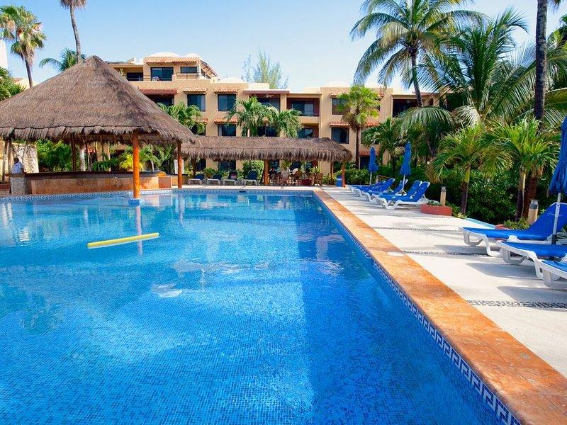Clean, Immaculate Beachfront 2nd Floor Condo #17 at Nautibeach, holiday rental in Playa Mujeres