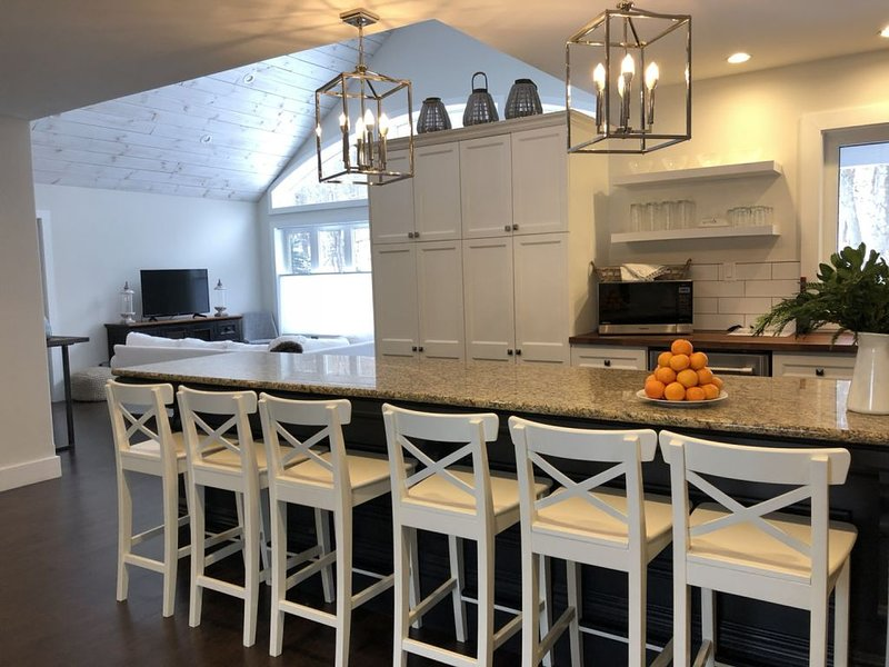 Kitchen with Antique 12 foot island, seating for 6 and a granite countertop