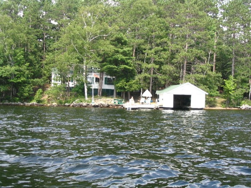 Lake of Bays -  patio and deck at waters edge, sun all day from 11:00 AM., holiday rental in Algonquin Provincial Park