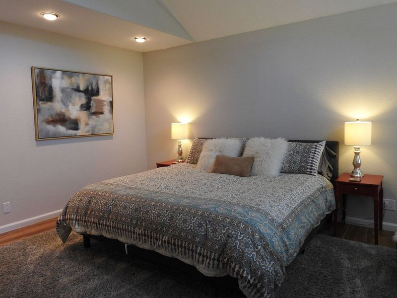 Master bedroom- King bedroom with vaulted ceilings, sitting area, & ensuite bath
