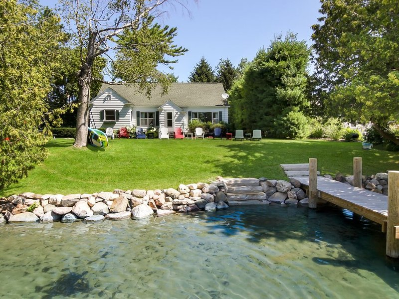 Leland Village River Front Beauty ~ Peaceful Neighborhood ~ Swim Off The Dock!, vakantiewoning in Leelanau County