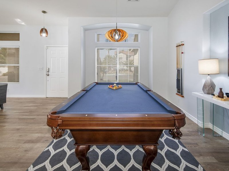 Our home features an indoor pool table, how fun!