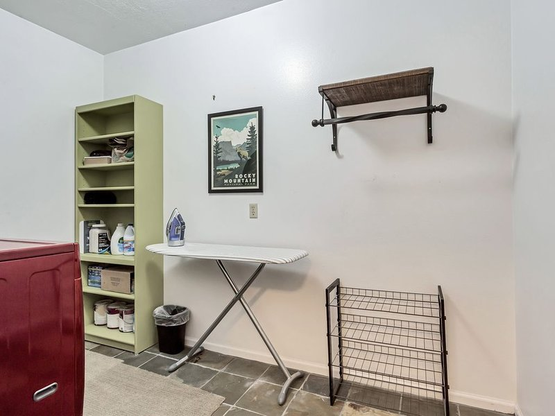 Laundry room with large washer/dryer