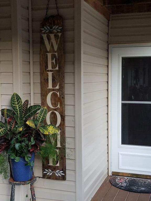 Bienvenue devant l'entrée