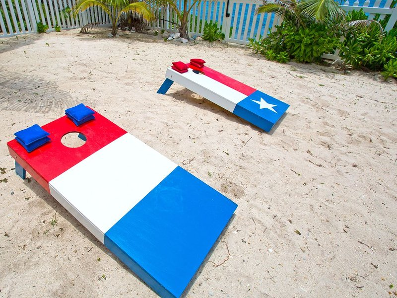 Play a game of cornhole by the pool area.