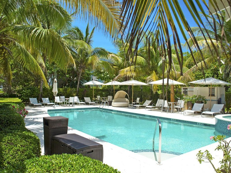 Beautiful pool surrounded by lush greenery.