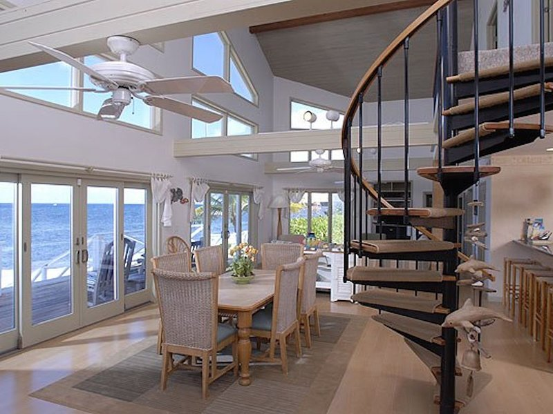 Dining area with vaulted ceilings and ocean views.