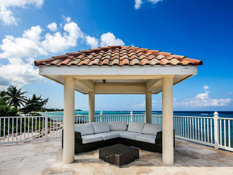 Relax in the outdoor sectional and listen to the waves roll over the shore.