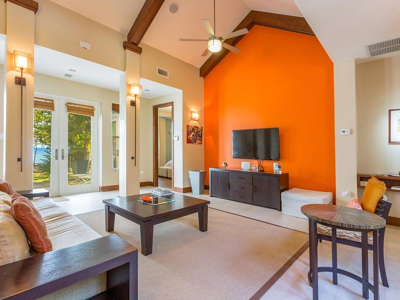 Papaya Cottage's living room with a flat screen TV