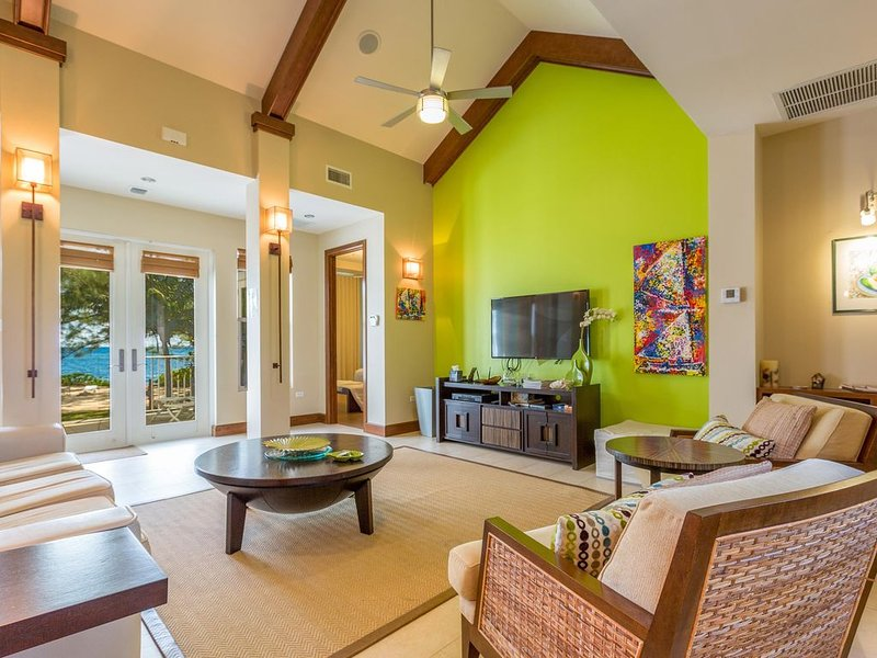Avocado Cottage's living room with a flat screen TV.