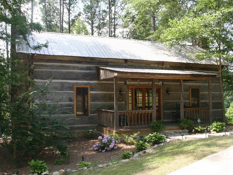 Looks Rustic But Luxury Awaits You at Two Cabins Lodge.  Lakefront with pool., holiday rental in Guntersville