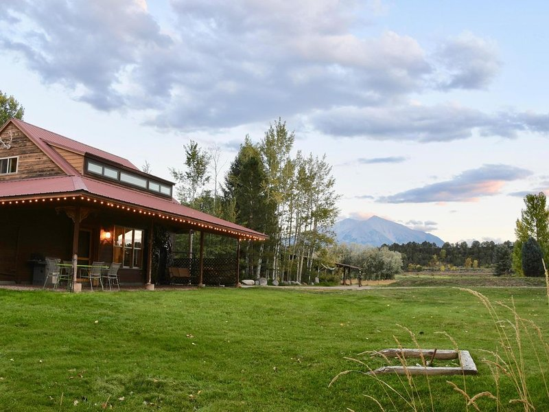 Side view of house, front yard and majestic Mt. Sopris