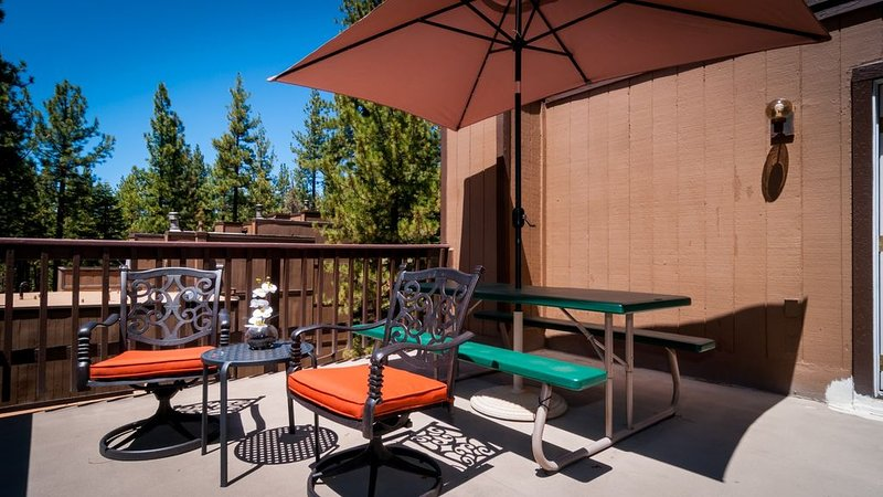 Large rooftop deck table umbrella seats 6 and table for 2