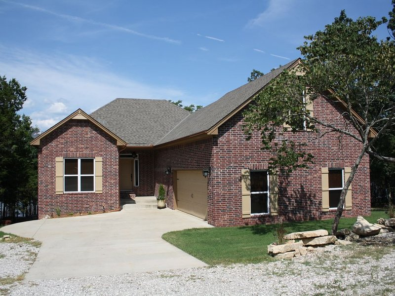 Custom brick lakefront home on Beaver Lake