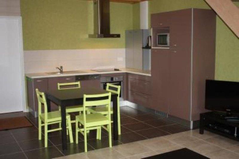 Cozinha e área de jantar