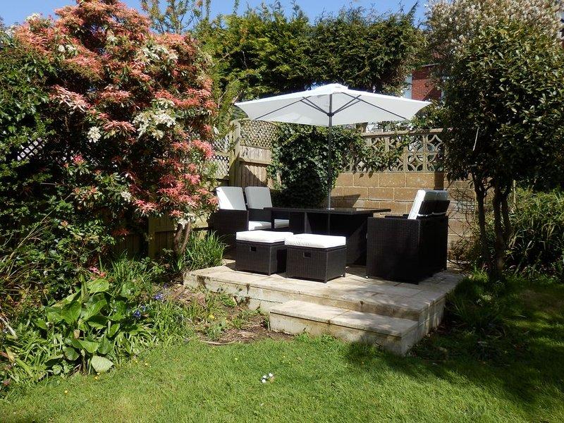 Sun trap patio in back garden.