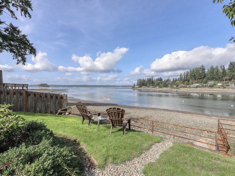 Waterfront home & on-site guest house w/ full kitchens, a large deck, & firepits, holiday rental in Lakebay