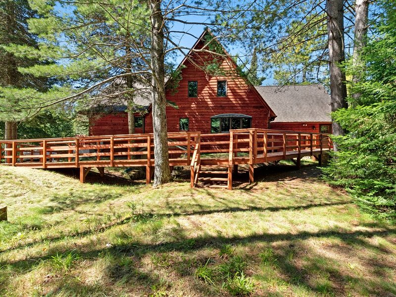 Charming, lakefront home w/ a dock, kayaks, gas grill, furnished deck, & firepit, vacation rental in Sayner